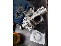 Bmw 520i e39 water pump and housing new