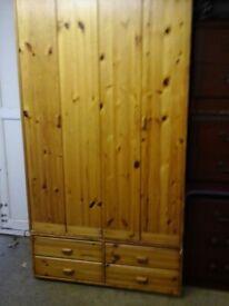 Pine double wardrobe with bi folding doors and shelves