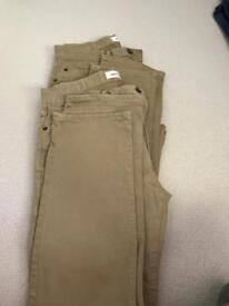 2 pairs of Gap slim fit stretch chinos.