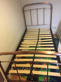 Single metal bed frame with slats