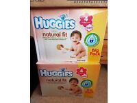 2 Boxes of huggies nappies - size 4