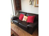 Two Brown Leather Sofa's