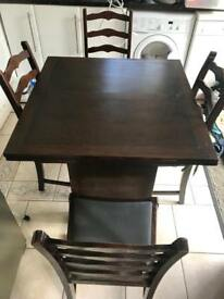 Late 1800's extending dining table and chairs