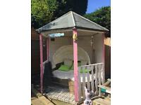 Pink and white wooden gazebo