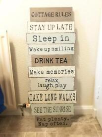 Large wooden cottage rules hanging wall plaque from the range