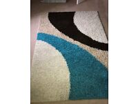 Lovely, modern design rug. 160 - 220 (5ft 3inches - 7ft 3inches). 2 years old. Very good condition.