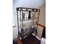 Ornate metal and glass display unit
