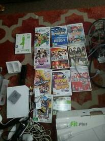 Nintendo wii console / wii fit board.games& lots of accessories
