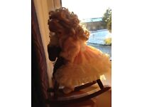 The Leonardo Collection Porcelain Doll on Rocking Horse. Certificate of Authenticity incl