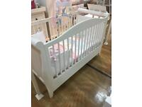 Sleigh style ivory cot bed