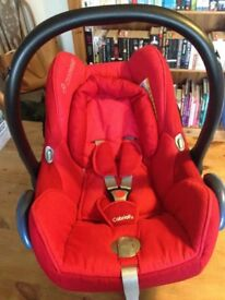 Used Maxi Cosi car seat with rain cover and sunshade. Suitable from birth.