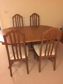 Excellent condition solid wood extendable dining table and chairs