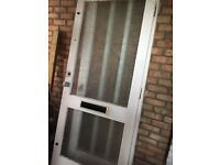 Exterior glazed wooden door with insulated letterbox.