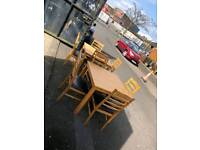 Pair of oak excentable table with 4 chairs with leather seating