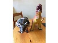 Two plastic large Dinosaurs