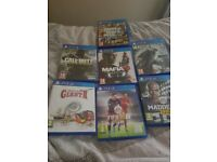 Ps4 console with blue controller and 7 games. GTA. COD. FIFA