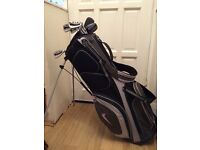 Adult Golf Clubs Srixon Irons 4-9 iron putter, PW. Nike Golf bag. Used, in good working condition.