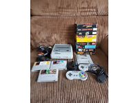Nintendo SNES in great condition with 12 games, 2 controllers and all original leads.