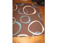 Blue, brown and cream rug