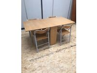 Foldaway table and chairs