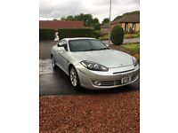 Well maintained silve hyundia coupe 2ltr,good condition