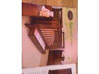 Boori walnut coloured sleigh cot bed with storage drawer that turns into a bed and then sofa