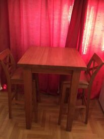 Oak bar style table and chairs