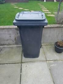 Large black wheelie bin