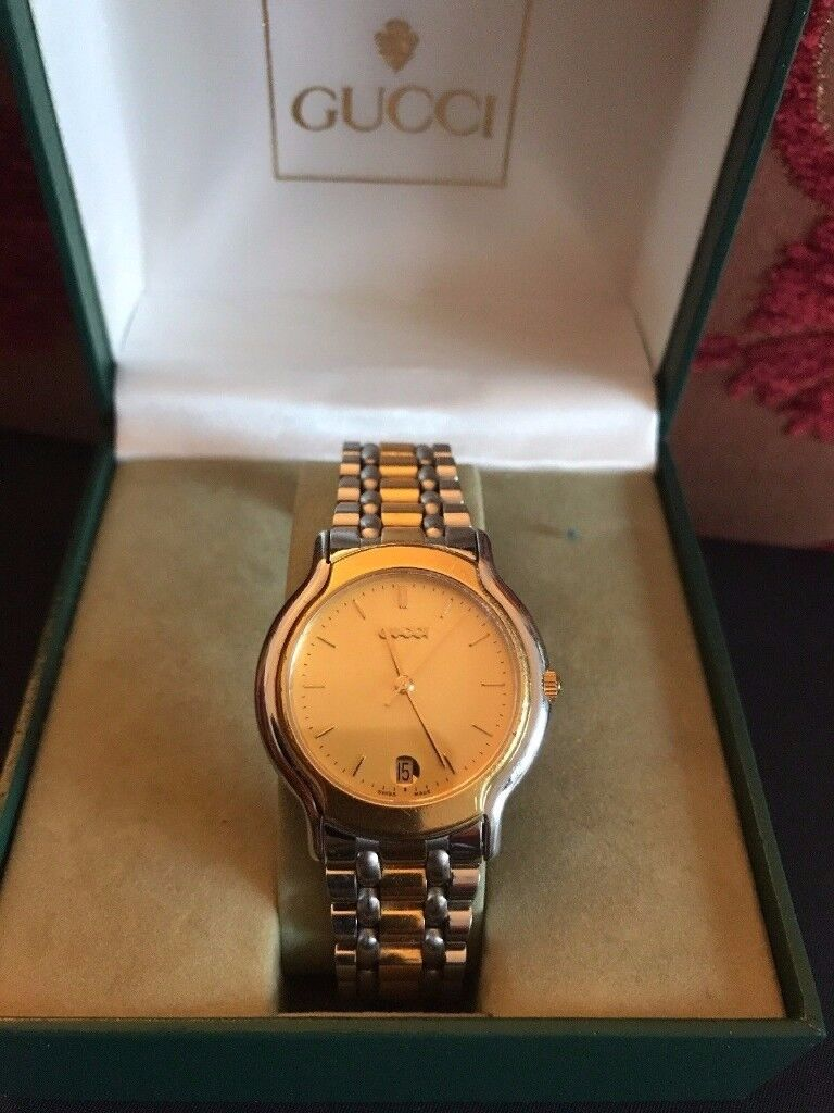 Gucci unisex watch 100% authenticity proven WITH box