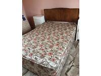 Double divan bed with wood headboard.