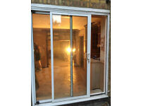 Aluminium patio door set, white frame, double-glazed, good security. £150. Highbury/Canonbury area.