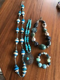 4 Pieces of chunky costume jewellery.