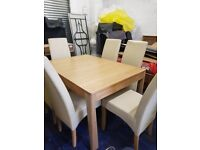Oak Dining Table and 6 leather chairs ( some damage )
