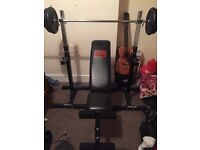 Adjustable bench , adjustable squat bars , weight bar and 60 kg of weight