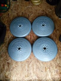Various vinyl York weight plates for sale