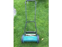Pull along lawn mower