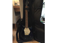 Switch electric guitar, generic case and Marshall amp together