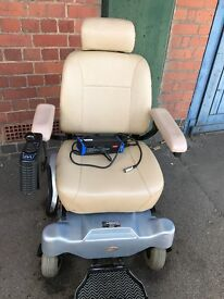 Pride Mobility Jazzy Power Chair 1120 In Light Blue.