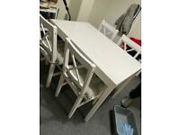 Dining room table and 4 chairs with seat pads