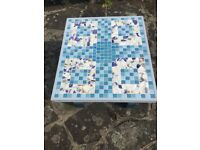 A mosaic patio coffee table