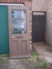 Old wooden Door with Stained Glass Window