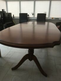 Cherry veneer extending dining room table in excellent condition
