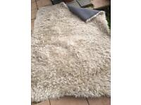 Cream with silver shimmer deep pile rug.