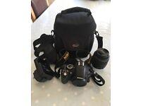 Nikon D3100 14.2MP Digital SLR Camera, AF-S NIKKOR 18-55mm VR lense, charger, battery and case