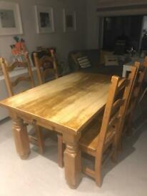 Solid rubber wood table and 4 very sturdy, heavy chairs.