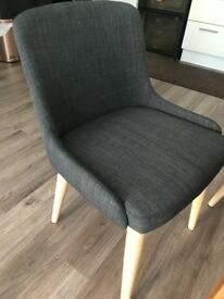 Four Grey fabric chairs