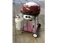 Revolution ® Gas Kettle Barbeque and nearly full 13kg butane gas cylinder.