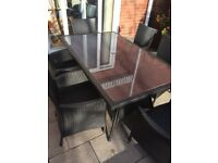 Large rectangular glass topped patio table and six chairs