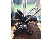 Mothercare Orb pram with adaptors.