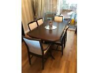 Stag Minstrel extendable dining table with 6 chairs including to carvers